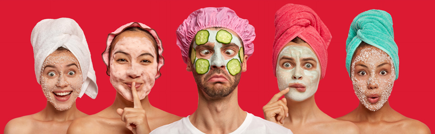 A disgruntled looking man with cucumbers and other beauty products on his face with women doing the same